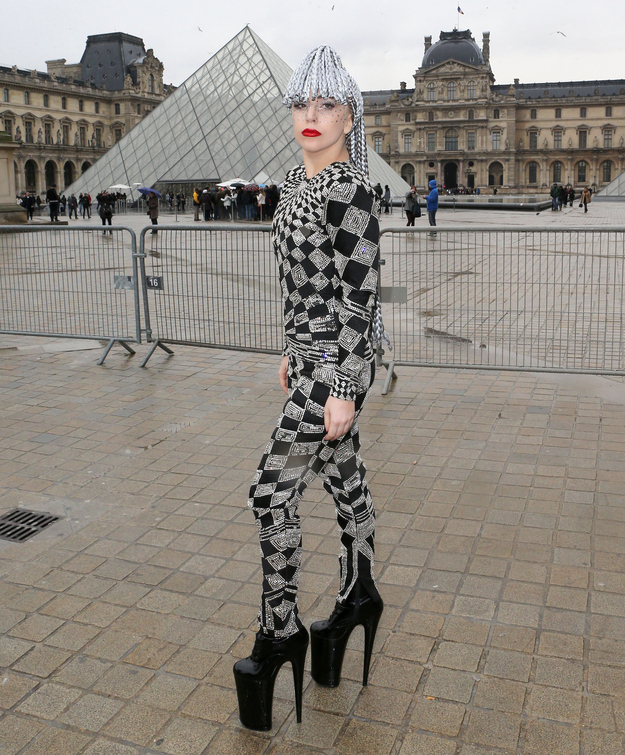 Lady Gaga Poses Outside Of The Louvre Museum In Silver Dreadlocks