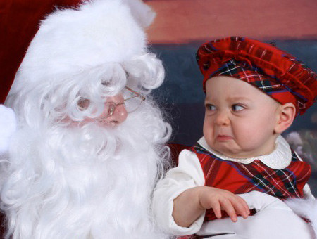 22 Kids Who Are Totally Over Taking Their Photo With Santa